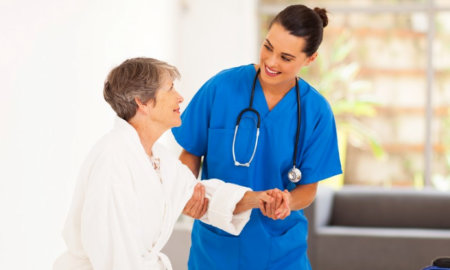 medical personel assisting a elderly person