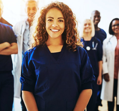 a woman medical staff smiling
