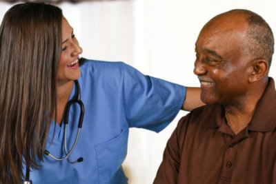 woman health care worker helping an elderly patient